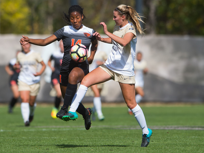 "Oregon State's Taylor Lemmond and CU's Mikaela Kraus fight for possession of the ball during the game in Prentup Field at CU Boulder on Sunday. CU defeated Oregon State 3-0. <br /> More photos:  <a href=""http://www.buffzone.com"">http://www.buffzone.com</a><br /> (Autumn Parry/Staff Photographer)<br /> October 9, 2016"