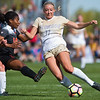 """Alex Vidger tries to kick the ball away from Oregon State's defense during the game in Prentup Field at CU Boulder on Sunday. CU defeated Oregon State 3-0. <br /> More photos:  <a href=""""http://www.buffzone.com"""">http://www.buffzone.com</a><br /> (Autumn Parry/Staff Photographer)<br /> October 9, 2016"""