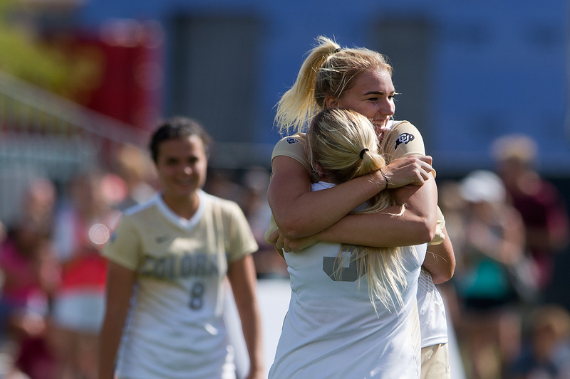 "CU's Emily Bruder hugs Taylor Kornieck after they scored against Oregon State during the game in Prentup Field at CU Boulder on Sunday. CU defeated Oregon State 3-0. <br /> More photos:  <a href=""http://www.buffzone.com"">http://www.buffzone.com</a><br /> (Autumn Parry/Staff Photographer)<br /> October 9, 2016"