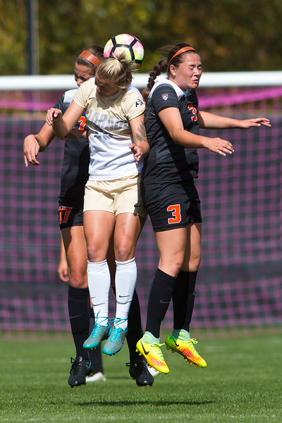 "Oregon State's Emma Bergstrom (right) head bumps the ball during the game in Prentup Field at CU Boulder on Sunday. CU defeated Oregon State 3-0. <br /> More photos:  <a href=""http://www.buffzone.com"">http://www.buffzone.com</a><br /> (Autumn Parry/Staff Photographer)<br /> October 9, 2016"