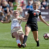 """CU's Taylor Korenieck kicks the ball past Oregon State's Kayla Latham during the game in Prentup Field at CU Boulder on Sunday. CU defeated Oregon State 3-0. <br /> More photos:  <a href=""""http://www.buffzone.com"""">http://www.buffzone.com</a><br /> (Autumn Parry/Staff Photographer)<br /> October 9, 2016"""