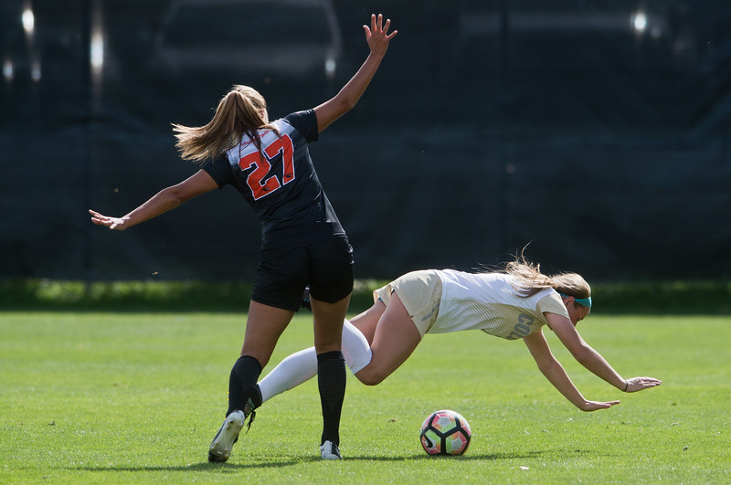 "CU's Danica Evans falls over the ball as Oregon State's Emma Rodriguez backs away, during the game in Prentup Field at CU Boulder on Sunday. CU defeated Oregon State 3-0. <br /> More photos:  <a href=""http://www.buffzone.com"">http://www.buffzone.com</a><br /> (Autumn Parry/Staff Photographer)<br /> October 9, 2016"