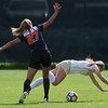 """CU's Danica Evans falls over the ball as Oregon State's Emma Rodriguez backs away, during the game in Prentup Field at CU Boulder on Sunday. CU defeated Oregon State 3-0. <br /> More photos:  <a href=""""http://www.buffzone.com"""">http://www.buffzone.com</a><br /> (Autumn Parry/Staff Photographer)<br /> October 9, 2016"""