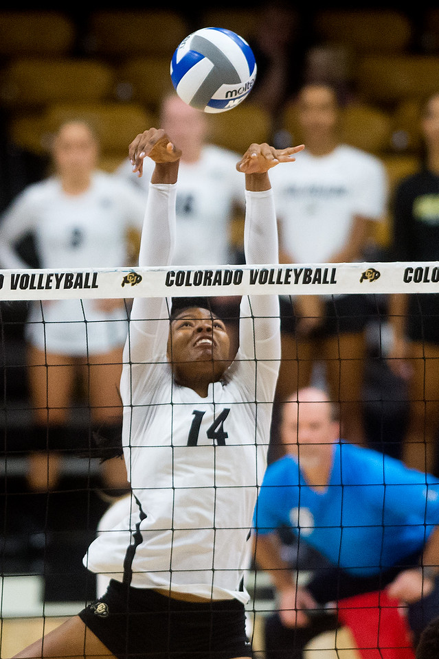 """CU's Naghede Abu hits one over the net during the game against Penn State at the Coors Event Center at CU Boulder on Saturday.<br /> For more photos go to  <a href=""""http://www.BoCoPreps.com"""">http://www.BoCoPreps.com</a><br /> (Autumn Parry/Staff Photographer)<br /> September 3, 2016"""
