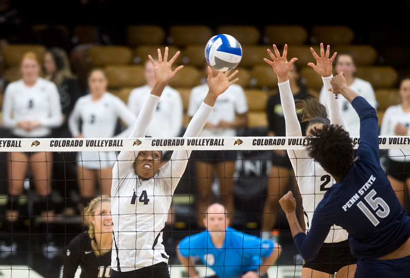 """CU's Naghede Abu hits one past Penn State's Haleigh Washington during the game at the Coors Event Center at CU Boulder on Saturday.<br /> For more photos go to  <a href=""""http://www.BoCoPreps.com"""">http://www.BoCoPreps.com</a><br /> (Autumn Parry/Staff Photographer)<br /> September 3, 2016"""