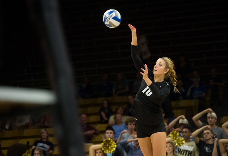 """CU's Cierra Simpson serves to Penn State during the game at the Coors Event Center at CU Boulder on Saturday.<br /> For more photos go to  <a href=""""http://www.BoCoPreps.com"""">http://www.BoCoPreps.com</a><br /> (Autumn Parry/Staff Photographer)<br /> September 3, 2016"""
