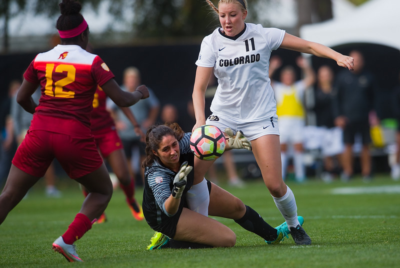 "Southern California's goalkeeper Sammy Jo Prudhomme makes a save as CU's Alex Vidger attempts to shoot and score during the game in Prentup Field at CU Boulder on Sunday. <br /> More photos:  <a href=""http://www.buffzone.com"">http://www.buffzone.com</a><br /> (Autumn Parry/Staff Photographer)<br /> October 30, 2016"