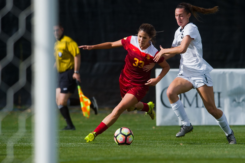 "Southern California's Katie Johnson kicks the ball past CU's Kelsey Aaknes during the game in Prentup Field at CU Boulder on Sunday. <br /> More photos:  <a href=""http://www.buffzone.com"">http://www.buffzone.com</a><br /> (Autumn Parry/Staff Photographer)<br /> October 30, 2016"