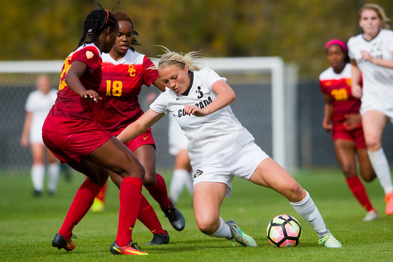 """CU's Emily Bruder tries to kick the ball past Southern California's Kayla Mills during the game in Prentup Field at CU Boulder on Sunday. <br /> More photos:  <a href=""""http://www.buffzone.com"""">http://www.buffzone.com</a><br /> (Autumn Parry/Staff Photographer)<br /> October 30, 2016"""
