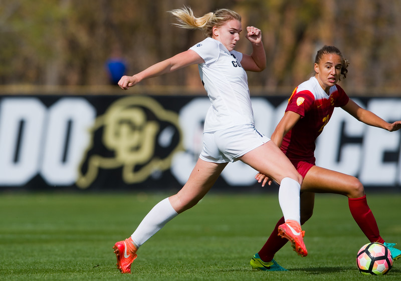 "CU's Taylor Kornieck kicks the ball past Ashleigh Plumptre during the game in Prentup Field at CU Boulder on Sunday. <br /> More photos:  <a href=""http://www.buffzone.com"">http://www.buffzone.com</a><br /> (Autumn Parry/Staff Photographer)<br /> October 30, 2016"