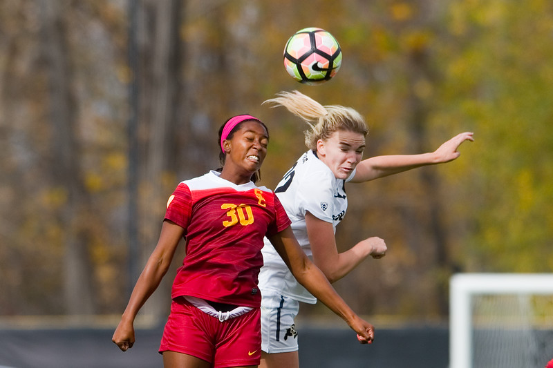 """Southern California's Sydney Johnson and CU's Taylor Kornieck head bump the ball during the game in Prentup Field at CU Boulder on Sunday. <br /> More photos:  <a href=""""http://www.buffzone.com"""">http://www.buffzone.com</a><br /> (Autumn Parry/Staff Photographer)<br /> October 30, 2016"""