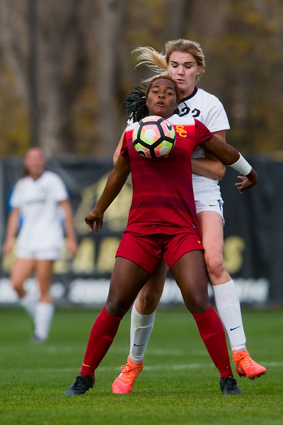 """Southern California's Kayla Mills bumps the ball away from CU's Taylor Kornieck during the game in Prentup Field at CU Boulder on Sunday. <br /> More photos:  <a href=""""http://www.buffzone.com"""">http://www.buffzone.com</a><br /> (Autumn Parry/Staff Photographer)<br /> October 30, 2016"""