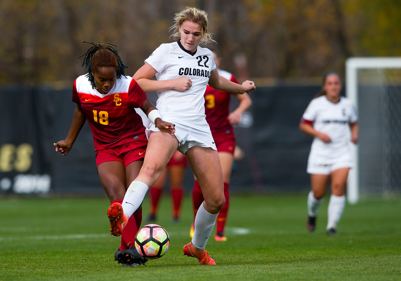 "CU's Taylor Kornieck kicks the ball away from Southern California's Kayla Mills during the game in Prentup Field at CU Boulder on Sunday. <br /> More photos:  <a href=""http://www.buffzone.com"">http://www.buffzone.com</a><br /> (Autumn Parry/Staff Photographer)<br /> October 30, 2016"