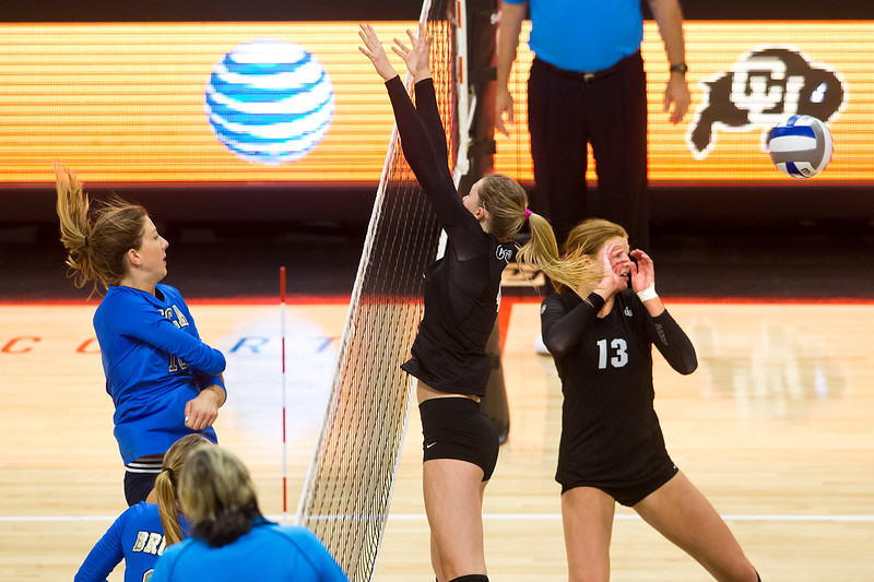 """UCLA hits one past CU's Gabby Simpson during the game in the Coors Event Center at CU Boulder on Sunday.<br /> More photos:  <a href=""""http://www.buffzone.com"""">http://www.buffzone.com</a><br /> (Autumn Parry/Staff Photographer)<br /> October 2, 2016"""