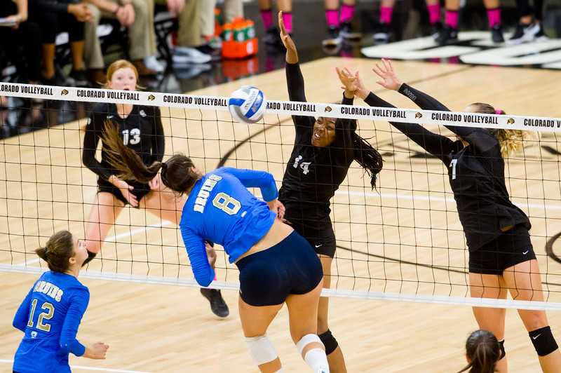 "CU's Naghede Abu blocks a hit by UCLA's Claire Felix during the game in the Coors Event Center at CU Boulder on Sunday.<br /> More photos:  <a href=""http://www.buffzone.com"">http://www.buffzone.com</a><br /> (Autumn Parry/Staff Photographer)<br /> October 2, 2016"