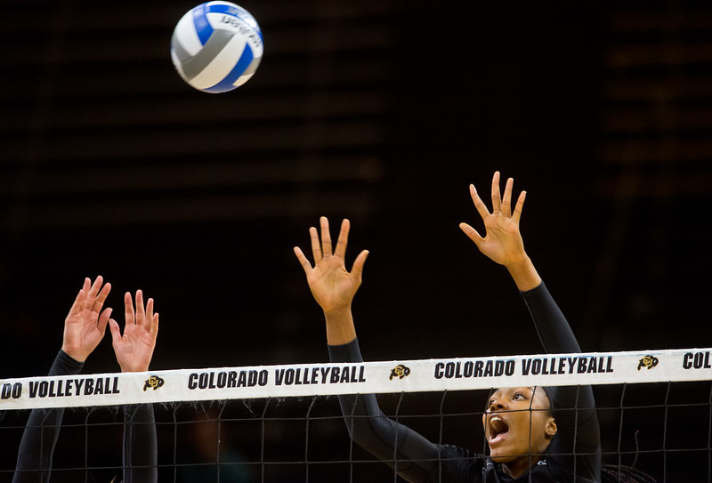 "CU's Naghede Abu blocks a hit by UCLA during the game in the Coors Event Center at CU Boulder on Sunday.<br /> More photos:  <a href=""http://www.buffzone.com"">http://www.buffzone.com</a><br /> (Autumn Parry/Staff Photographer)<br /> October 2, 2016"