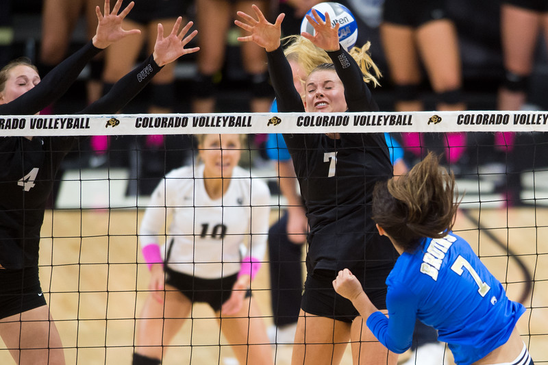 "CU's Alexa Smith misses the ball during an attempt to block a hit by UCLA during the game against UCLA in the Coors Event Center at CU Boulder on Sunday.<br /> More photos:  <a href=""http://www.buffzone.com"">http://www.buffzone.com</a><br /> (Autumn Parry/Staff Photographer)<br /> October 2, 2016"