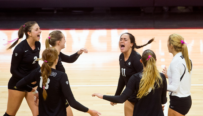 "CU's Kiara McKibben (center) celebrates with her team after they scored against UCLA during the game in the Coors Event Center at CU Boulder on Sunday.<br /> More photos:  <a href=""http://www.buffzone.com"">http://www.buffzone.com</a><br /> (Autumn Parry/Staff Photographer)<br /> October 2, 2016"