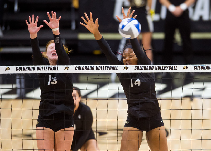 "CU's Gabby Simpson (left) and Naghede Abu block a hit by UCLA during the game in the Coors Event Center at CU Boulder on Sunday.<br /> More photos:  <a href=""http://www.buffzone.com"">http://www.buffzone.com</a><br /> (Autumn Parry/Staff Photographer)<br /> October 2, 2016"