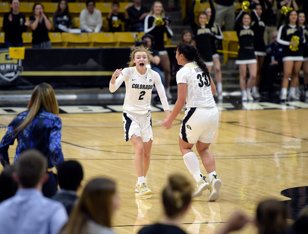 . BOULDER, CO - FEBRUARY 10: The University of Colorado\'s Alexis Robinson, left, celebrates her three pointer late in the fourth quarter with teammate Peanut Tuitele which sealed their team\'s 81-76 win against the University of Southern California\' February 10, 2019. The Buffaloes won To view more photos visit buffzone.com. (Photo by Lewis Geyer/Staff Photographer)