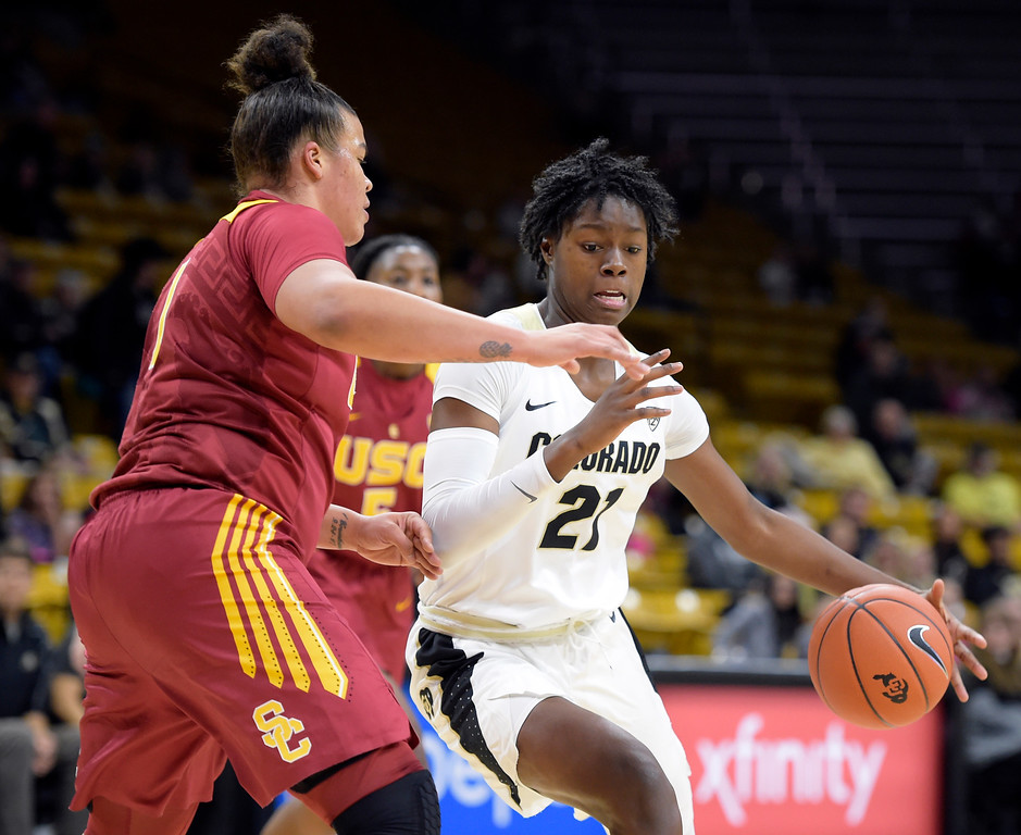 . BOULDER, CO - FEBRUARY 10: The University of Colorado\'s Mya Hollingshed drives to the basket next to the University of Southern California\'s Kayla Overbeck in the first quarter February 10, 2019. To view more photos visit buffzone.com. (Photo by Lewis Geyer/Staff Photographer)