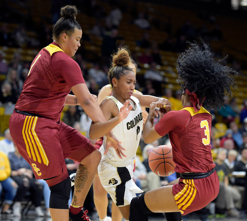 . BOULDER, CO - FEBRUARY 10: University of Colorado\'s Quinessa Caylao-Do has the ball knocked away by the University of Southern California\'s Kayla Overbeck, left, and Minyon Moore in the first quarter February 10, 2019. To view more photos visit buffzone.com. (Photo by Lewis Geyer/Staff Photographer)
