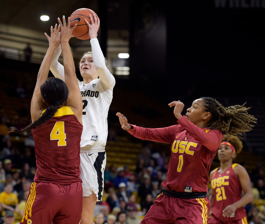 . BOULDER, CO - FEBRUARY 10: The University of Colorado\'s Alexis Robinson takes a shot over the University of Southern California\'s Mariya Moore as USC\'s Shalexxus Aaron covers from the side in the first quarter February 10, 2019. To view more photos visit buffzone.com. (Photo by Lewis Geyer/Staff Photographer)