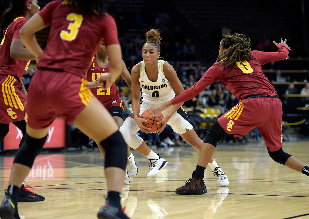 . BOULDER, CO - FEBRUARY 10: The University of Colorado\'s Quinessa Caylao-Do handles the ball at the top of the key between the University of Southern California\'s Aliyah Mazyck and Shalexxus Aaron n the first quarter February 10, 2019. To view more photos visit buffzone.com. (Photo by Lewis Geyer/Staff Photographer)