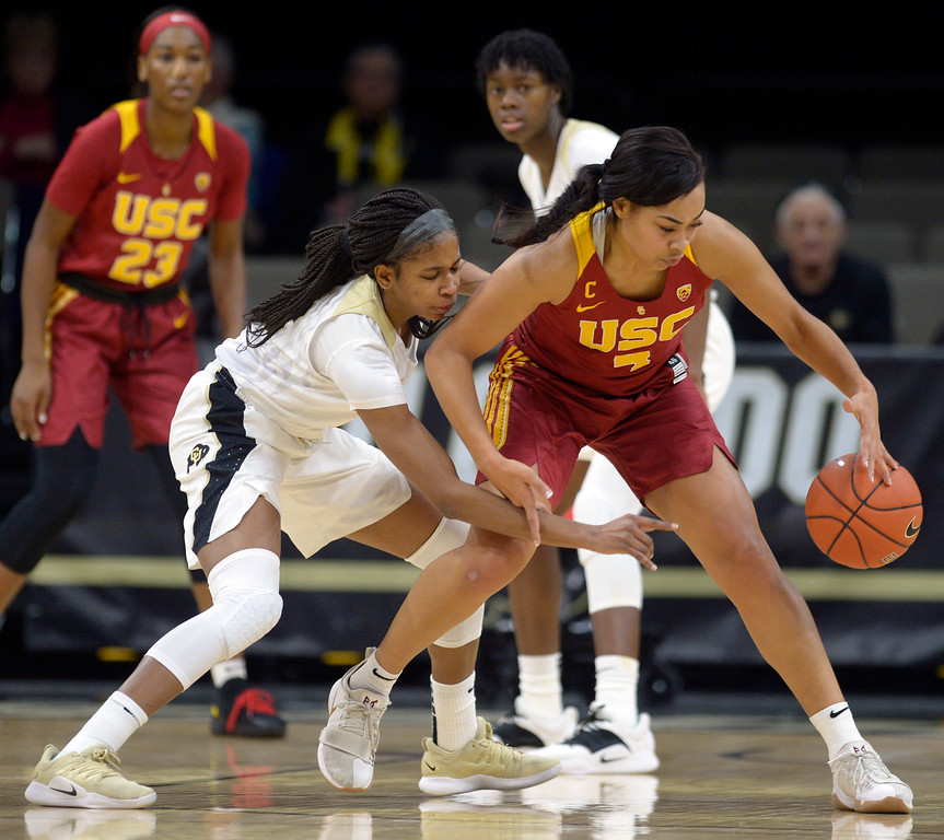 . BOULDER, CO - FEBRUARY 10: The University of Colorado\'s Mathilde Diop reaches in on the University of Southern California\'s Mariya Moore in the first quarter February 10, 2019. To view more photos visit buffzone.com. (Photo by Lewis Geyer/Staff Photographer)