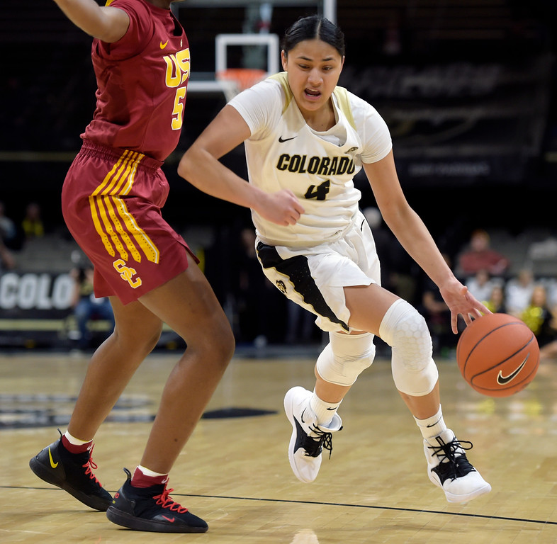 . BOULDER, CO - FEBRUARY 10: The University of Colorado\'s Lesila Finau drives around the University of Southern California\'s Ja\'Tavia Tapley in the second quarter February 10, 2019. To view more photos visit buffzone.com. (Photo by Lewis Geyer/Staff Photographer)