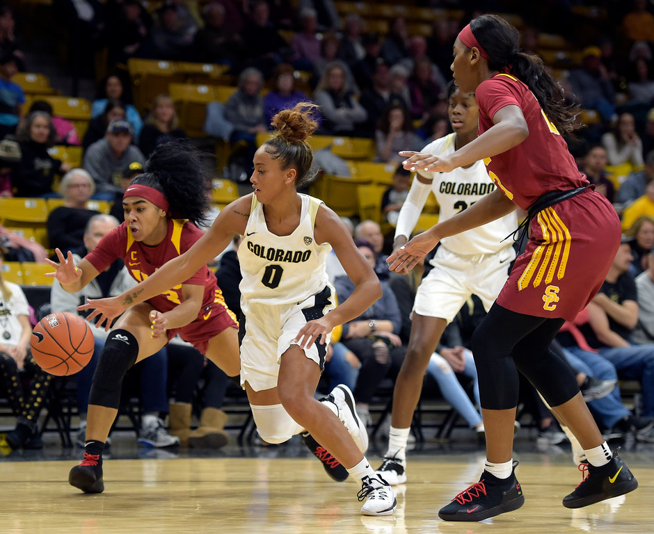 . BOULDER, CO - FEBRUARY 10: The University of Colorado\'s Quinessa Caylao-Do has the ball knocked away by the University of Southern California\'s Minyon Moore in the second quarter February 10, 2019. To view more photos visit buffzone.com. (Photo by Lewis Geyer/Staff Photographer)