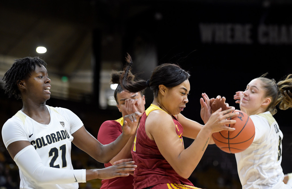 . BOULDER, CO - FEBRUARY 10: The University of Southern California\'s Mariya Moore grabs a rebound between the University of Colorado\'s Mya Hollingshed, left, and Emma Clarke in the first quarter February 10, 2019. To view more photos visit buffzone.com. (Photo by Lewis Geyer/Staff Photographer)