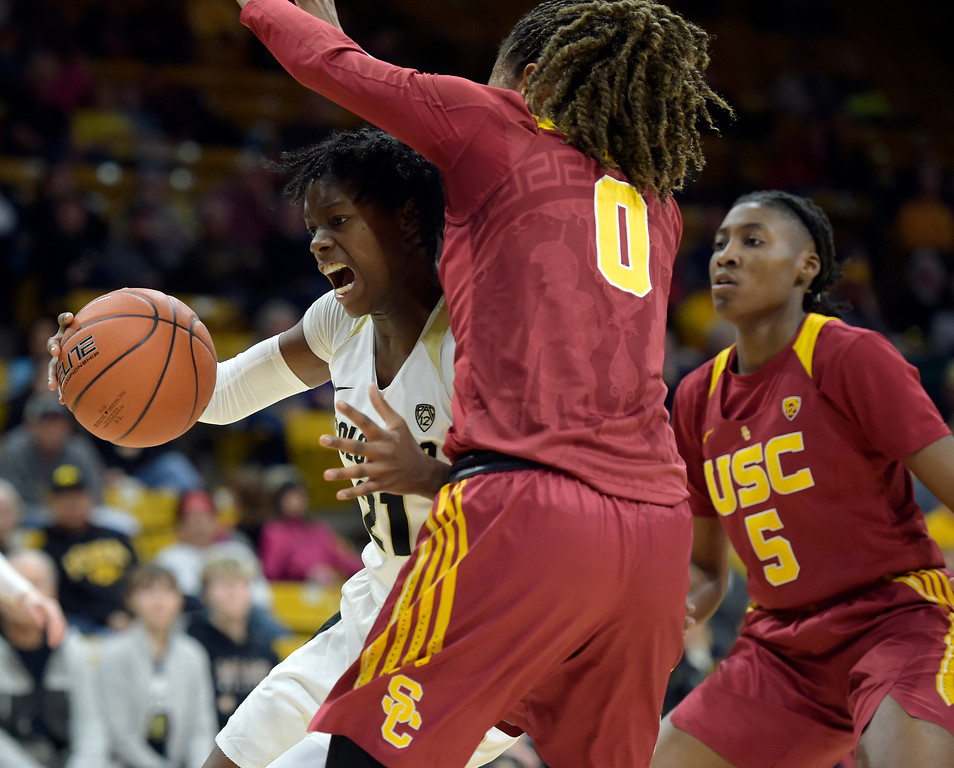 . BOULDER, CO - FEBRUARY 10: The University of Colorado\'s Mya Hollingshed drives up against the University of Southern California\'s Shalexxus Aaron as USC\'s Ja\'Tavia Tapley covers from behind in the second quarter February 10, 2019. To view more photos visit buffzone.com. (Photo by Lewis Geyer/Staff Photographer)