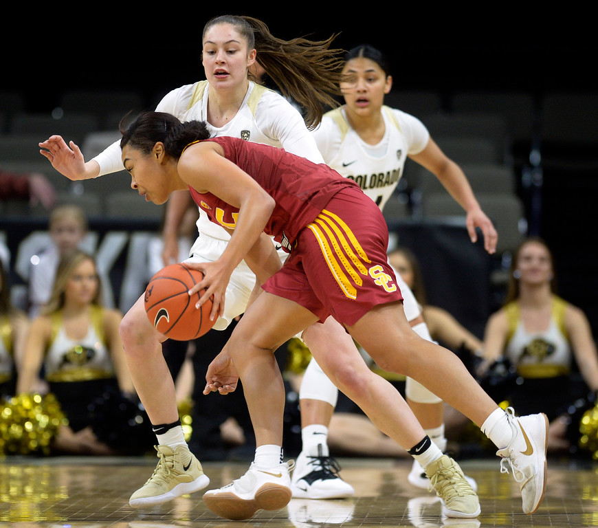 . BOULDER, CO - FEBRUARY 10: The University of Colorado\'s Emma Clarke covers the University of Southern California\'s Mariya Moore in the first quarter February 10, 2019. To view more photos visit buffzone.com. (Photo by Lewis Geyer/Staff Photographer)