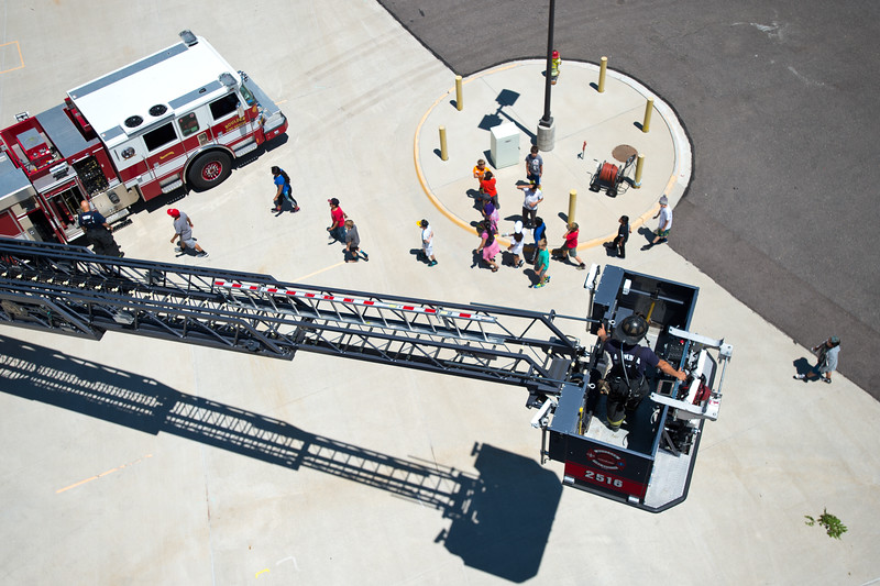 "Firefighter Ryan Boersma descends in the bucket of a ladder truck to take another group of kids up to the top of the training tower during Camp Boulder Fire at the Boulder Wildland Fire Training Center on Thursday. <br /> More photos:  <a href=""http://www.dailycamera.com"">http://www.dailycamera.com</a><br /> (Autumn Parry/Staff Photographer)<br /> June 9, 2016"