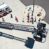 """Firefighter Ryan Boersma descends in the bucket of a ladder truck to take another group of kids up to the top of the training tower during Camp Boulder Fire at the Boulder Wildland Fire Training Center on Thursday. <br /> More photos:  <a href=""""http://www.dailycamera.com"""">http://www.dailycamera.com</a><br /> (Autumn Parry/Staff Photographer)<br /> June 9, 2016"""