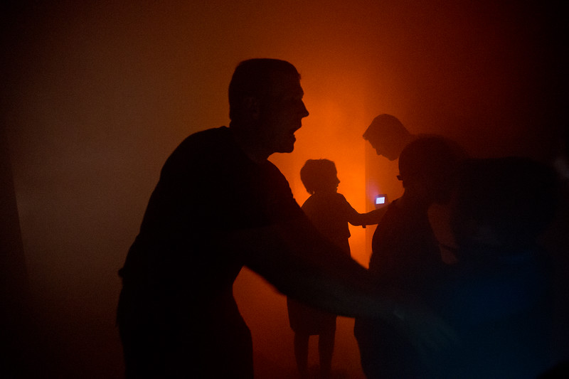 "Lieutenant Matt Zavala takes kids through a theater smoke-filled room, which simulates what it's like to enter a burning building, and teaches them how to use a thermal imaging camera to see gradients in heat, during Camp Boulder Fire at the Boulder Wildland Fire Training Center on Thursday. <br /> More photos:  <a href=""http://www.dailycamera.com"">http://www.dailycamera.com</a><br /> (Autumn Parry/Staff Photographer)<br /> June 9, 2016"