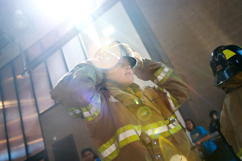 "Jackson Kirshner, 10, from University Hill Elementary, tries on personal protective equipment during Camp Boulder Fire at the Boulder Wildland Fire Training Center on Thursday. The kids spent the day learning about what it takes to be a firefighter and participated in team building exercises.<br /> More photos:  <a href=""http://www.dailycamera.com"">http://www.dailycamera.com</a><br /> (Autumn Parry/Staff Photographer)<br /> June 9, 2016"
