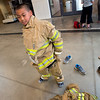 """Guanyu Hou, 11, from Creekside Elementary, puts on personal protective equipment during Camp Boulder Fire at the Boulder Wildland Fire Training Center on Thursday. The camp is intended to teach the children about what it takes to be a firefighter and engages them in team building exercises.<br /> More photos:  <a href=""""http://www.dailycamera.com"""">http://www.dailycamera.com</a><br /> (Autumn Parry/Staff Photographer)<br /> June 9, 2016"""