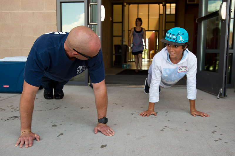 "Fire Investigator Lance Day leads a series of push-ups with Eric Terral, 13, from Nevin Platt Middle School, during Camp Boulder Fire at the Boulder Wildland Fire Training Center on Thursday. The camp is intended to teach the children about what it takes to be a firefighter and engages them in team building exercises.<br /> More photos:  <a href=""http://www.dailycamera.com"">http://www.dailycamera.com</a><br /> (Autumn Parry/Staff Photographer)<br /> June 9, 2016"