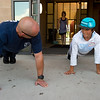 """Fire Investigator Lance Day leads a series of push-ups with Eric Terral, 13, from Nevin Platt Middle School, during Camp Boulder Fire at the Boulder Wildland Fire Training Center on Thursday. The camp is intended to teach the children about what it takes to be a firefighter and engages them in team building exercises.<br /> More photos:  <a href=""""http://www.dailycamera.com"""">http://www.dailycamera.com</a><br /> (Autumn Parry/Staff Photographer)<br /> June 9, 2016"""