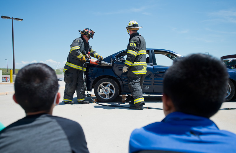 "Chief Fire Marshal Dave Lowrey (right) helps remove a door as part of a car extrication scenario during Camp Boulder Fire at the Boulder Wildland Fire Training Center on Thursday. <br /> More photos:  <a href=""http://www.dailycamera.com"">http://www.dailycamera.com</a><br /> (Autumn Parry/Staff Photographer)<br /> June 9, 2016"