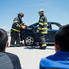 """Chief Fire Marshal Dave Lowrey (right) helps remove a door as part of a car extrication scenario during Camp Boulder Fire at the Boulder Wildland Fire Training Center on Thursday. <br /> More photos:  <a href=""""http://www.dailycamera.com"""">http://www.dailycamera.com</a><br /> (Autumn Parry/Staff Photographer)<br /> June 9, 2016"""