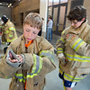 """Avery Nasta, 10, from Manhattan Middle School, tries on personal protective equipment during Camp Boulder Fire at the Boulder Wildland Fire Training Center on Thursday. <br /> More photos:  <a href=""""http://www.dailycamera.com"""">http://www.dailycamera.com</a><br /> (Autumn Parry/Staff Photographer)<br /> June 9, 2016"""