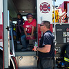 """Victor Gonzalez, 10, from Columbine Elementary,  talks with a firefighter while sitting in one of the trucks during Camp Boulder Fire at the Boulder Wildland Fire Training Center on Thursday. <br /> More photos:  <a href=""""http://www.dailycamera.com"""">http://www.dailycamera.com</a><br /> (Autumn Parry/Staff Photographer)<br /> June 9, 2016"""