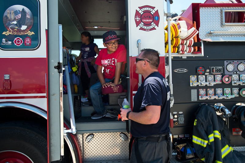 "Victor Gonzalez, 10, from Columbine Elementary,  talks with a firefighter while sitting in one of the trucks during Camp Boulder Fire at the Boulder Wildland Fire Training Center on Thursday. <br /> More photos:  <a href=""http://www.dailycamera.com"">http://www.dailycamera.com</a><br /> (Autumn Parry/Staff Photographer)<br /> June 9, 2016"