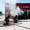 "Lieutenant Matt Zavala and Engineer Eric Begin put out a fire as part of a live burn scenario during Camp Boulder Fire at the Boulder Wildland Fire Training Center on Thursday. <br /> More photos:  <a href=""http://www.dailycamera.com"">http://www.dailycamera.com</a><br /> (Autumn Parry/Staff Photographer)<br /> June 9, 2016"