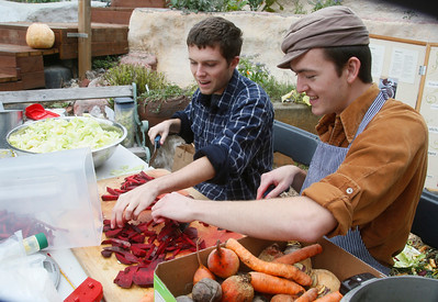 Biology major Jacob Smith, left, and Campus Center for Appropriate Technology organic gardener and botany major Sebastian Forward prepare for a canning and pickling workshop at the center's Harvest Fest on Friday at Humboldt State University. The event also featured free food, music, information tables, and other workshops for students and community members. (Shaun Walker -- The Times-Standard)