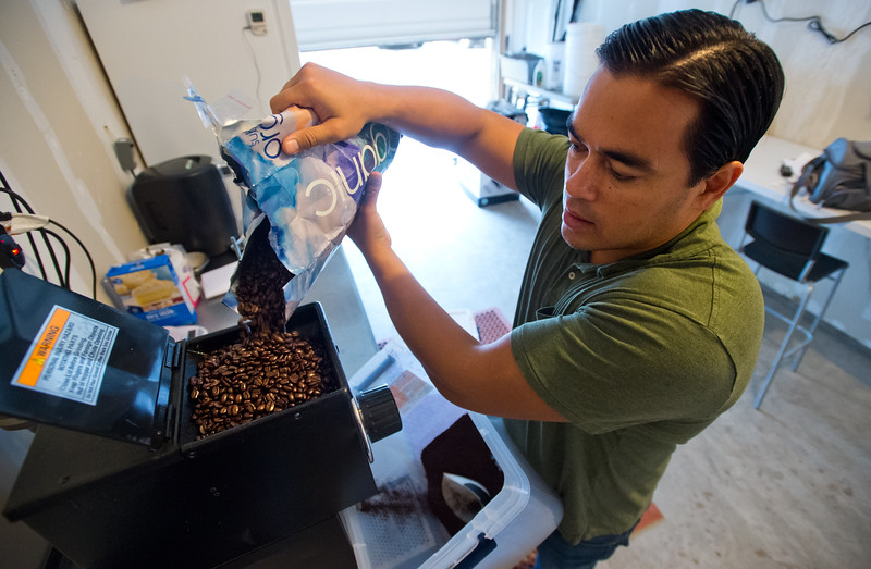 "Jason Walsh pours coffee beans into a grinder as he begins to cold brew coffee at his home in Louisville on Friday. Walsh infuses cannabis oil into his coffee product, Native Jack, which is currently being sold in local grocery stores like Alfalfa's Market. <br /> More photos:  <a href=""http://www.dailycamera.com"">http://www.dailycamera.com</a><br /> (Autumn Parry/Staff Photographer)<br /> September 2, 2016"