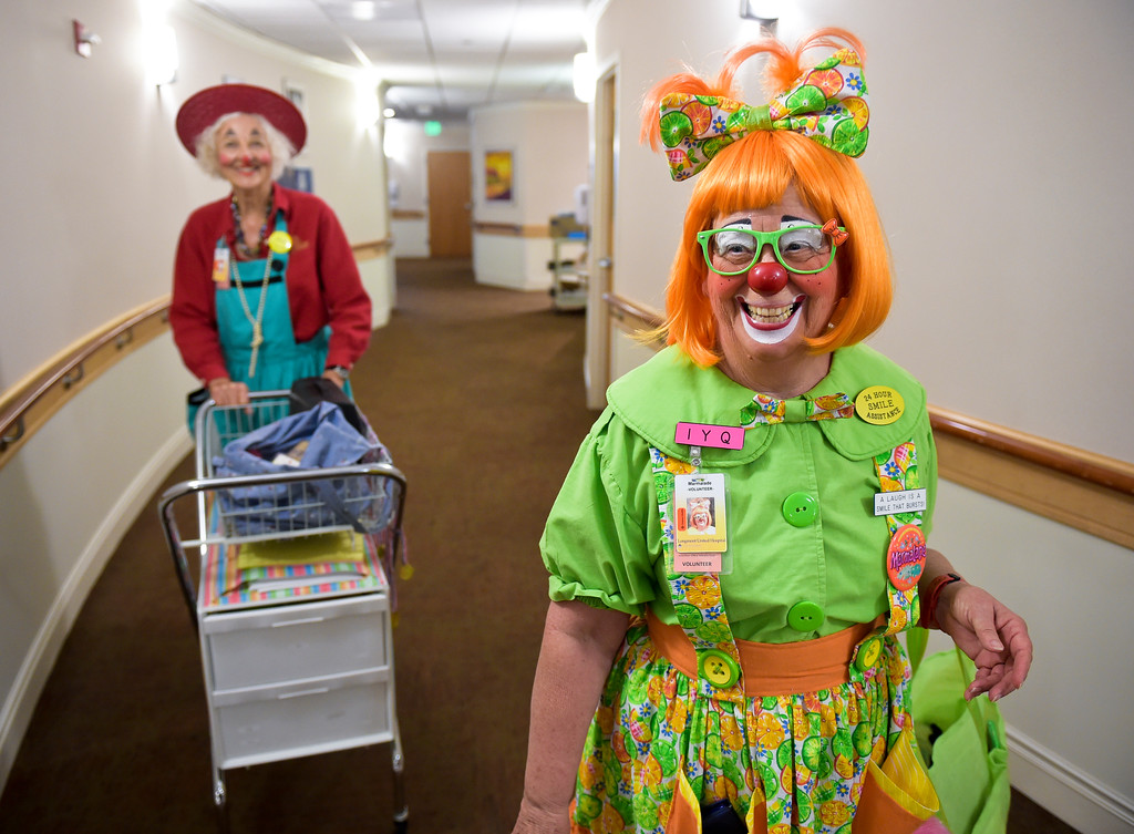 ". Caring Clowns volunteers Loretta ""Madame Larkspur\"" Milburn, left, and Kathy \""Marmalade\"" Shook walk to another patient\'s room on the fifth floor at Longmont United Hospital, 1950 Mountain View Ave., Tuesday morning. They are being photographed by Emma\'s mother Deepa McCauley. To view more photos and a video visit timescall.com. Lewis Geyer/Staff Photographer Sept. 12, 2017"